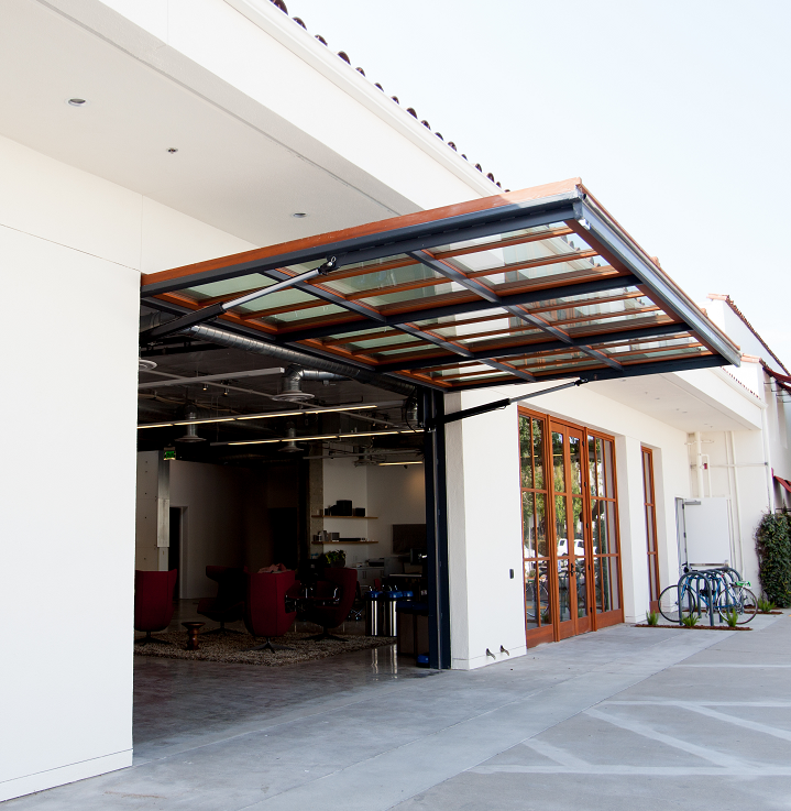 The Premier Single Piece System In The Market The Single Swing Is The Premier Hydraulically Operated Sing Garage Doors Garage Door Design Single Garage Door