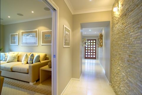 stack stone feature. grey wall with white trim and beige floor ...