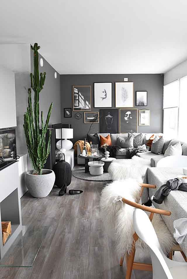 A Contemporary Grey Living Room And Dining With Walls Large Planter Ceiling High Cactus Sectional Sofa Hints Of Cognac Hues