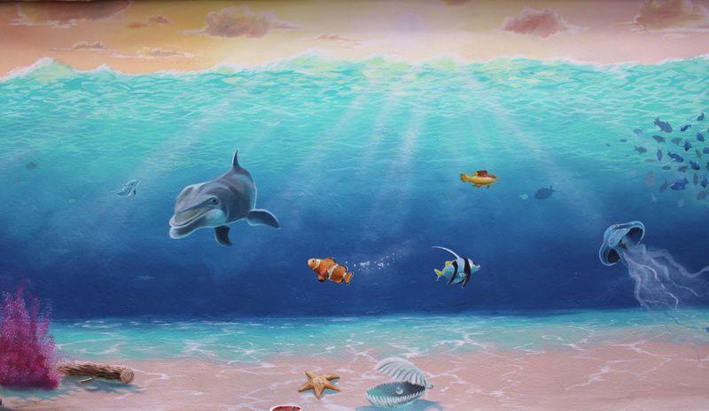 Kinderaugen mit Unterwasserwelt zum Leuchten gebracht
