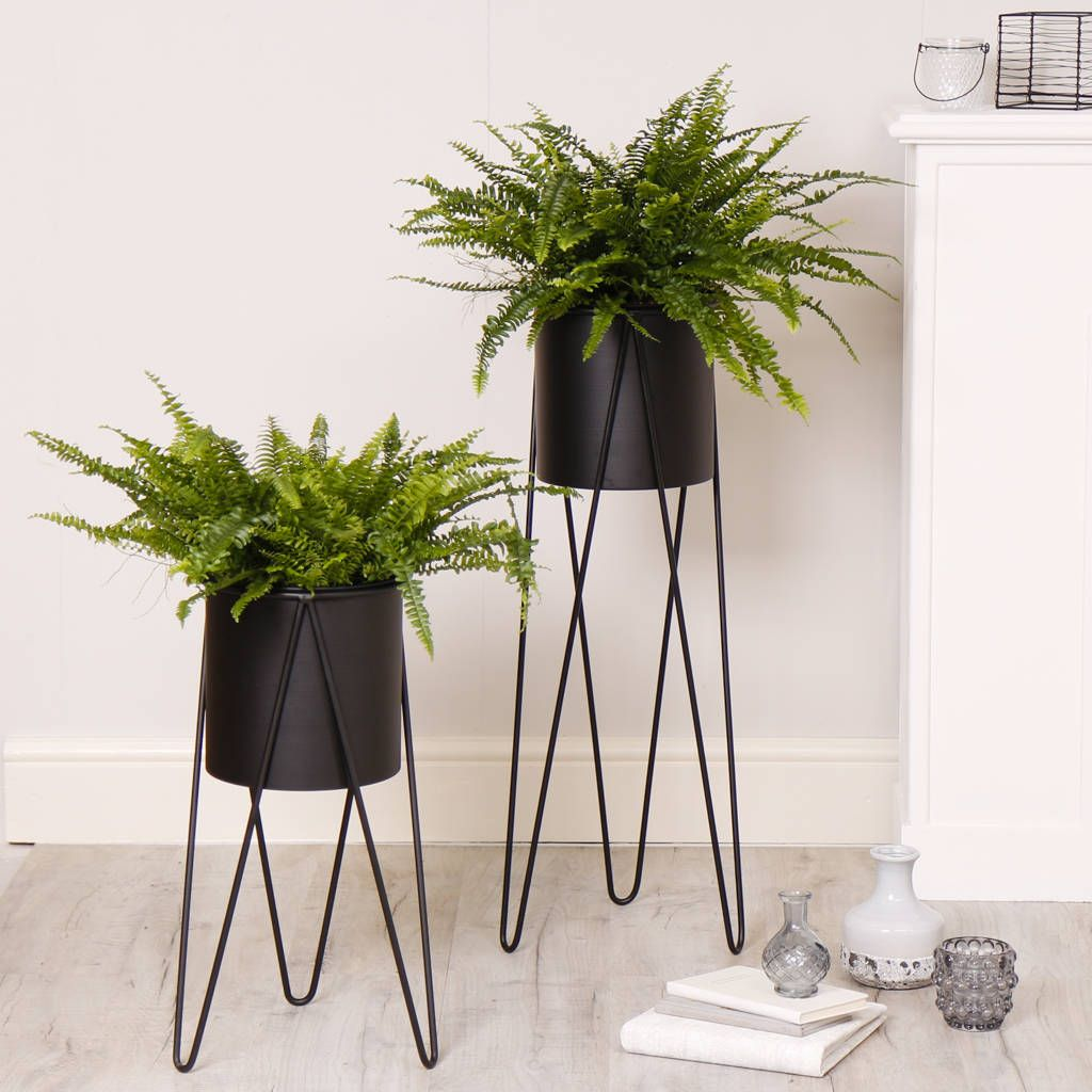 Contemporary black metal drum planter with stand with