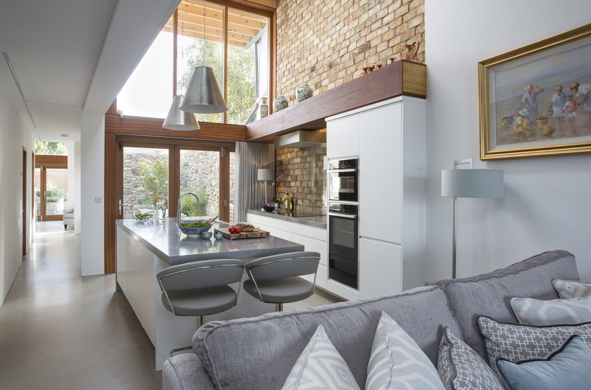 Exposed brick walls and concrete floors define one of the latest ...