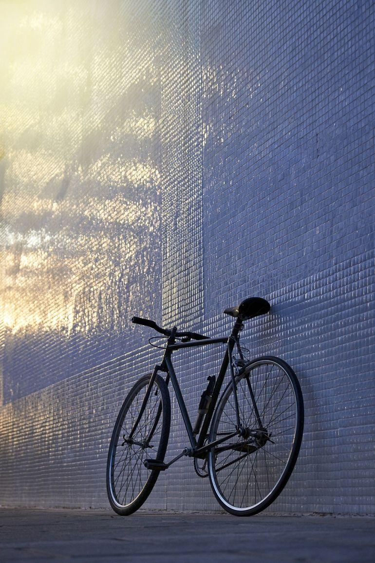 Bike against wall in glow light