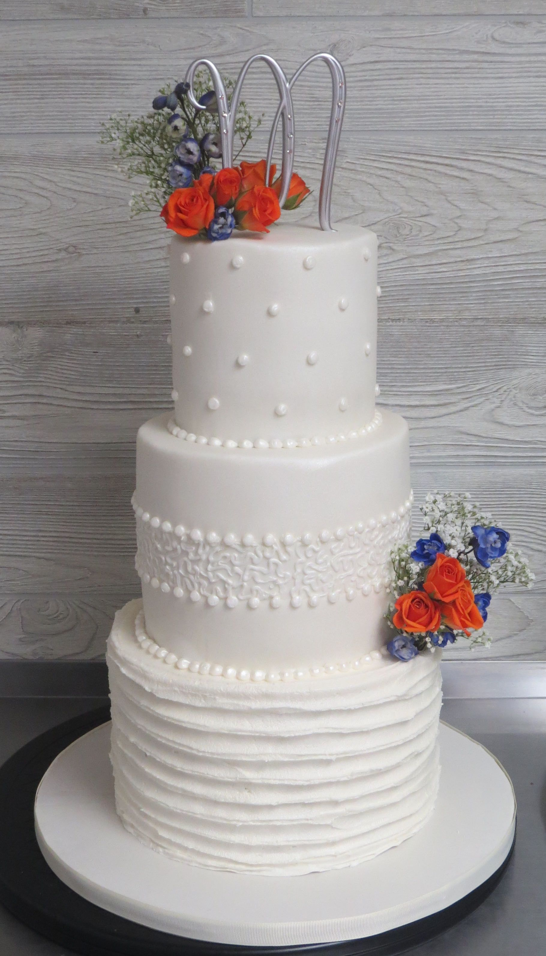 Simple, elegant wedding cake decorated with pearls and lace ...