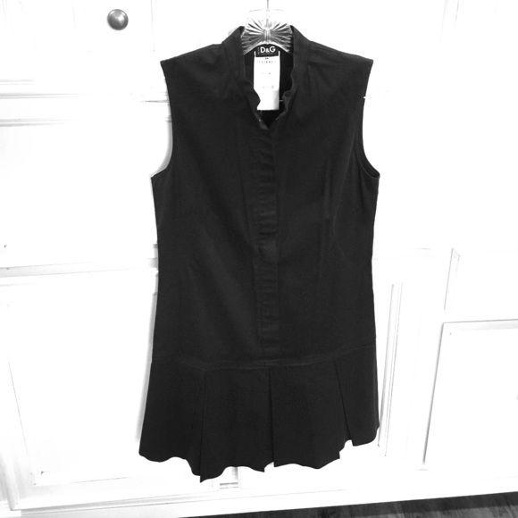 Dolce & Gabbana Dress Sleeveless, darted bodice, drop waist, pleated skirt, front zip, small snap fastening at top of short collar. Hardly worn Dolce & Gabbana Dresses Mini