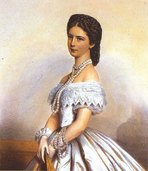 1867 Sisi wearing white  Empress Elizabeth wears a half-cone dress, cuffed gloves, and spectacular pearls in this 1867 image.