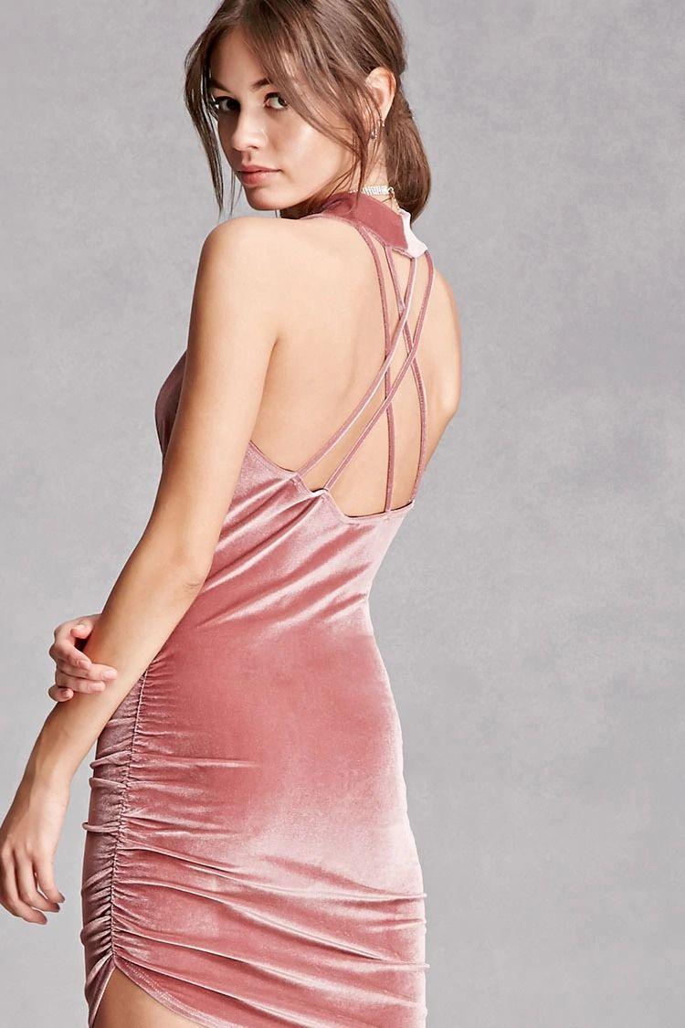A knit velvet bodycon dress featuring a mini length, a sleeveless ...