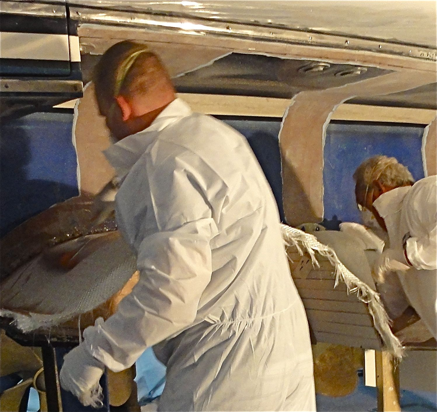 Applying resin to the fiberglass so that the hull extension we are manufacturing for this 70' Marlow is good and strong!