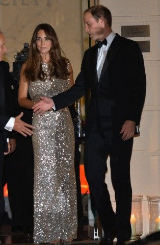 Prince William, Duke of Cambridge and Catherine, Duchess of Cambridge depart the inaugural awards ceremony honouring those who work for wildlife conservation, held at the Royal Society, London