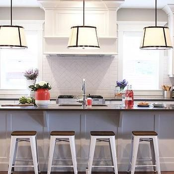 White Kitchen Island with Gray Countertop Lined with White Tolix