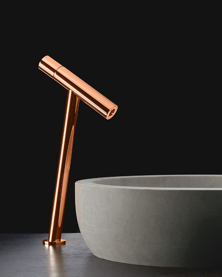 Copper mixer with a blue bateig stone Moon washbasin. Design by Lavernia & Cienfuegos for Sanico. #bathroomdecorideas #bathroomsets