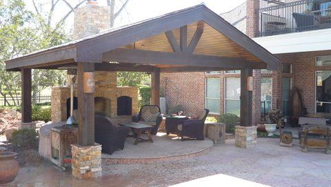 Outdoor Fireplace And Living With A Patio Pavillion Back