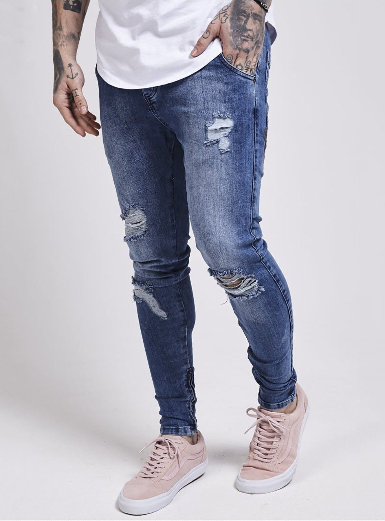 9983020a06 Stretch denim - Drop crotch - Concealed button fly - Distressed detailing -  Ankle zip