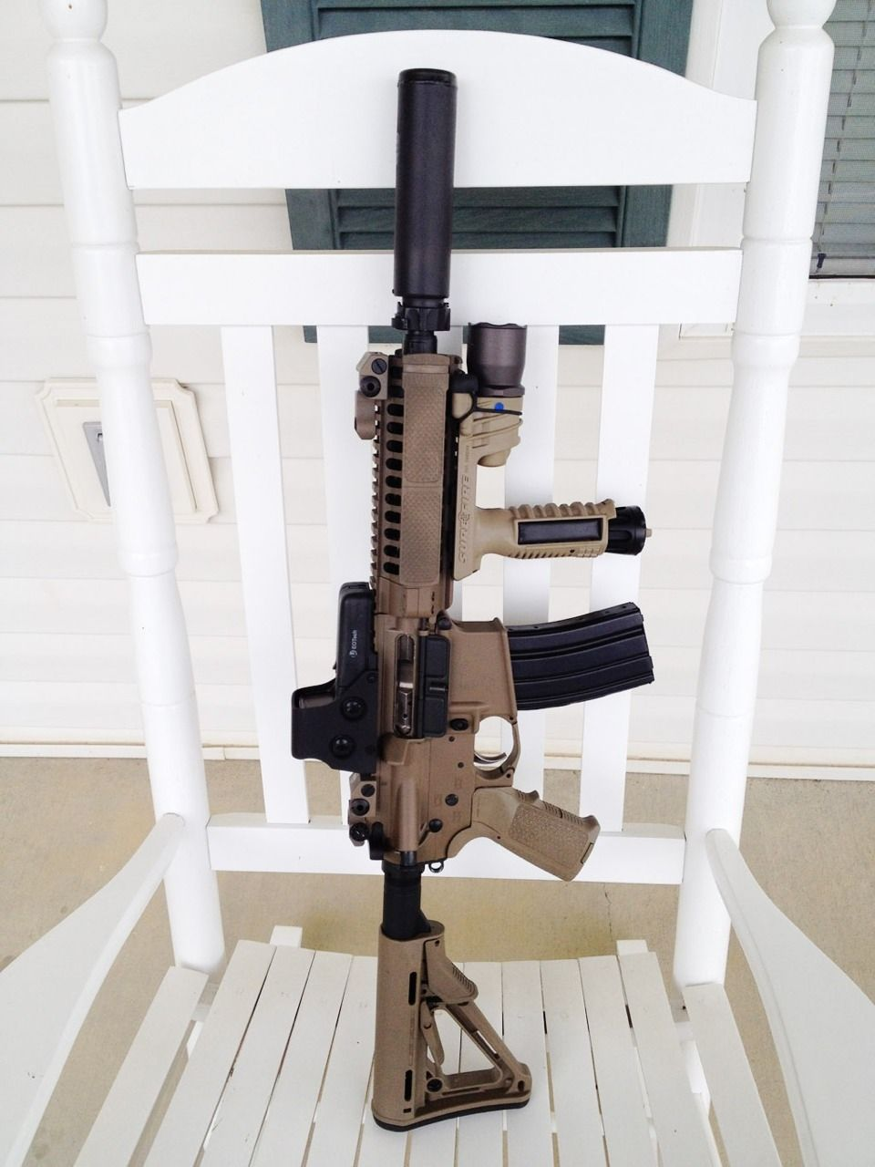 This is what ill be holding when im 70 years old rocking on my front porch and a custom rocking chair holster with an hk usp for secondary