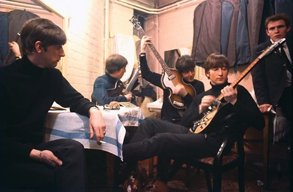 The Beatles with Neil Aspinall in 1963 backstage at the Cavern Club