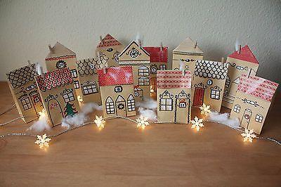 Adventskalender Dorf, Häuser, Stadt Handarbeit aus Papiertüten zu befühlen Advent calendar