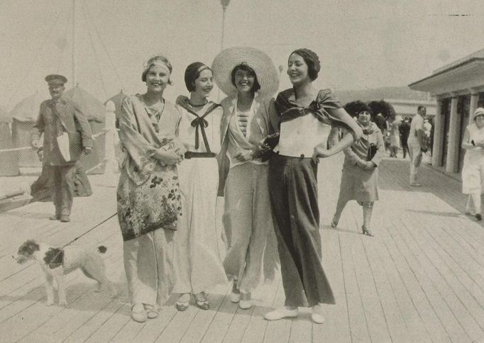 Loving the wide legged pantsuits from the 30s. This photo is from 1932. 30s fashion style found photo street boardwalk day lounge wear beach