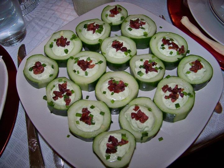 Cucumber Chive Cups - filled with chive dressing and garnished with chopped kalamata olives and fresh chives.
