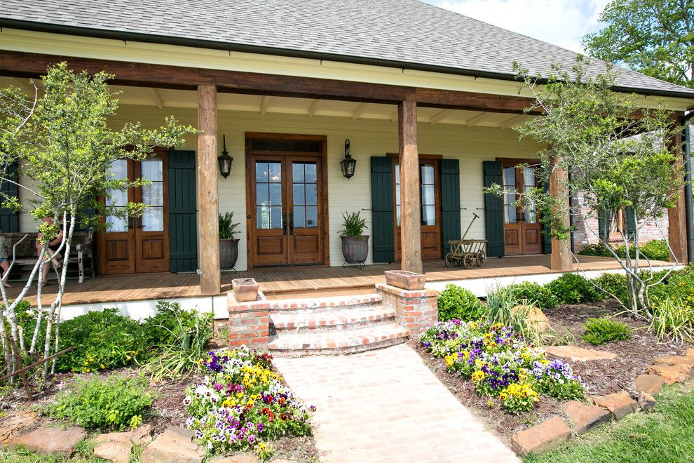 French doors cypress columns front porch ranch house for House plans with columns and porches