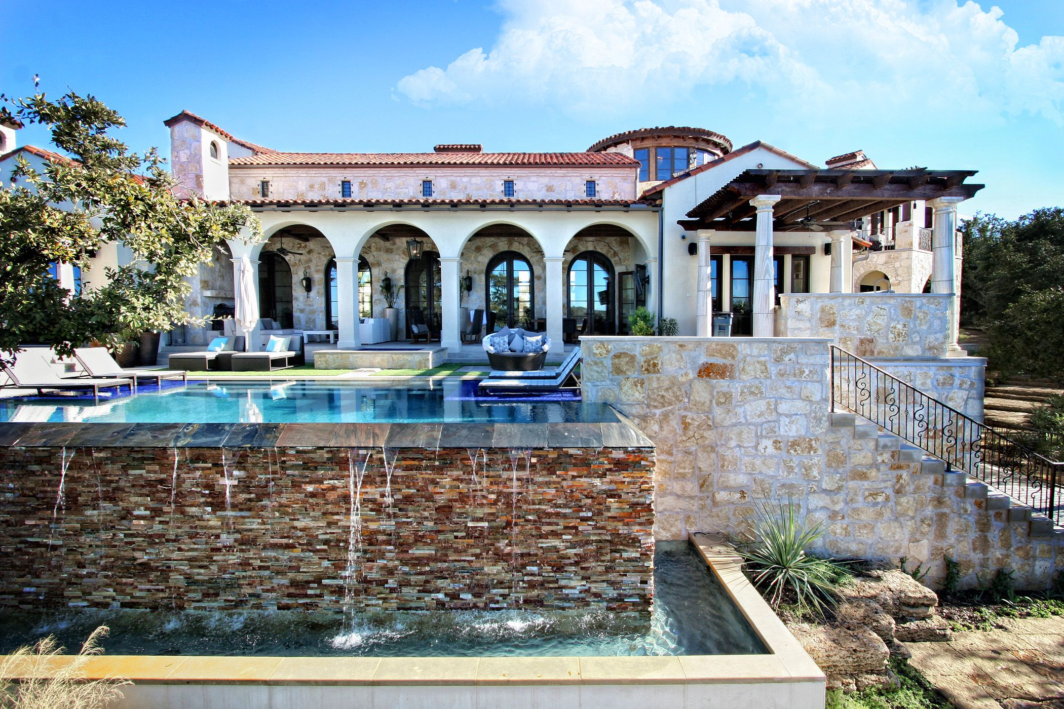 Horseshoe bay eclectic spanish lake house pool elevation for Lake house builders