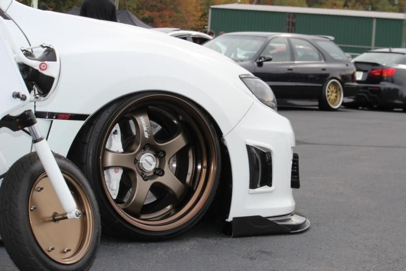 Bronze Work Wheels On White Subaru