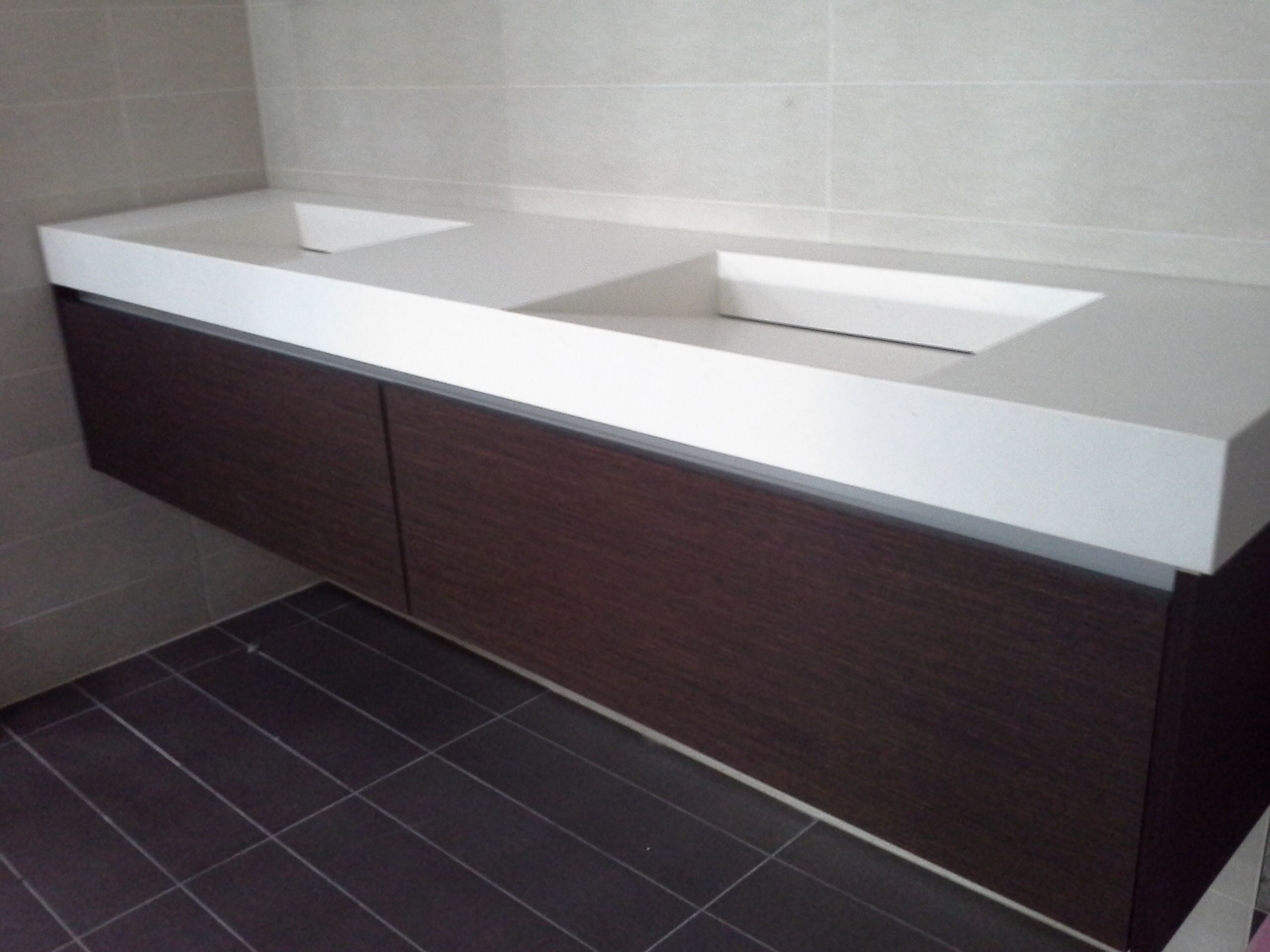 Floating Vanity, White Corian Top With Integrated Sinks That Slope  Backwards, Timber Drawers Under