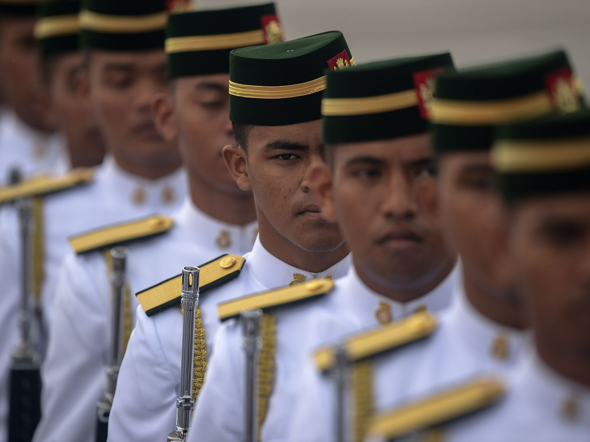 A Royal Malay Regiment honor guard marches in front of Air Force One ahead  of President
