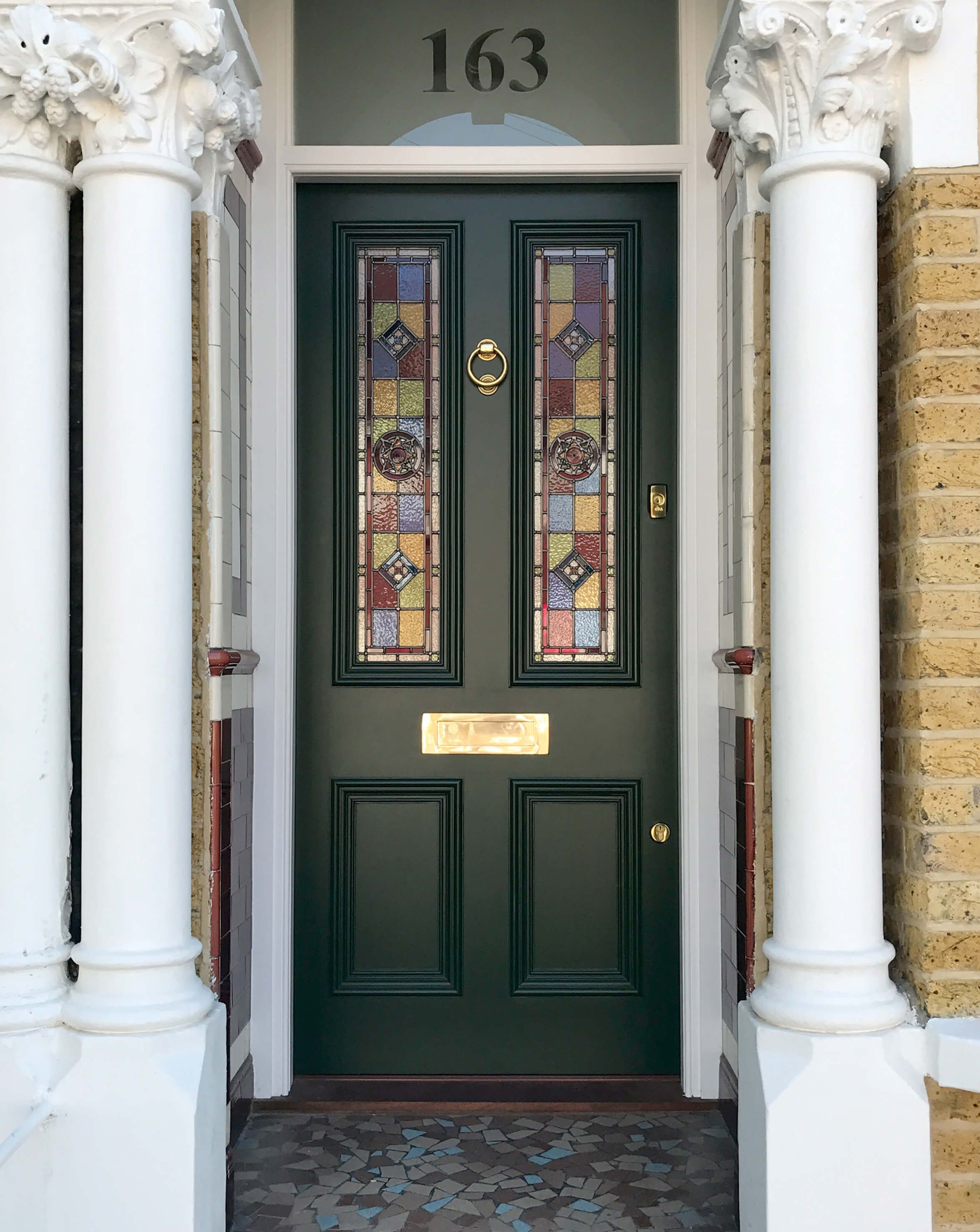 Stunning green victorian door designed and hand made with coloured stained glass panels opaque fanlight with inlaid door number and classic brass door