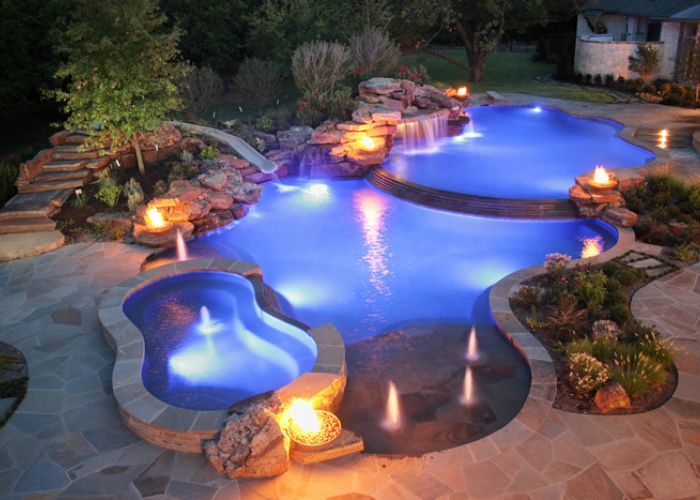 Fire and water fountains photos fire water backyards for Best pool design 2015