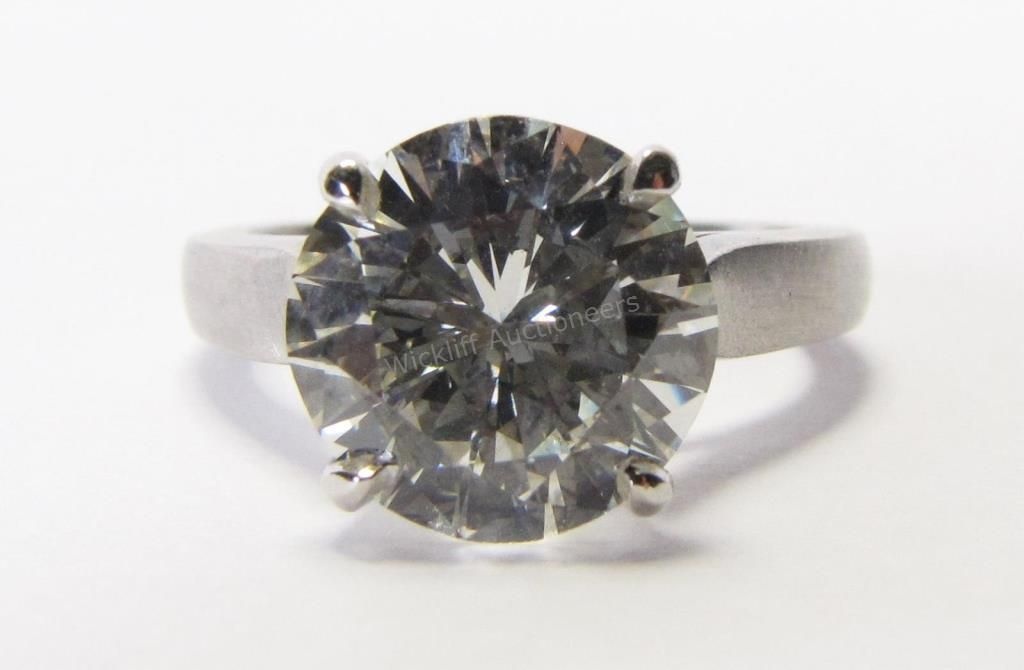 A Platinum Diamond Ring Containing An Ags Certified 321ct Center