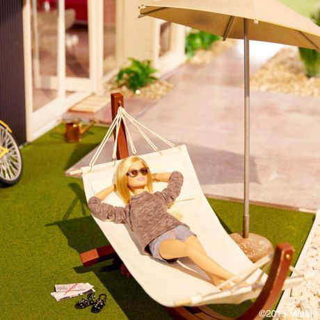 Barbie's hammock is perfect for relaxing after a long day, or perhaps reading the paper on a Saturday morning.