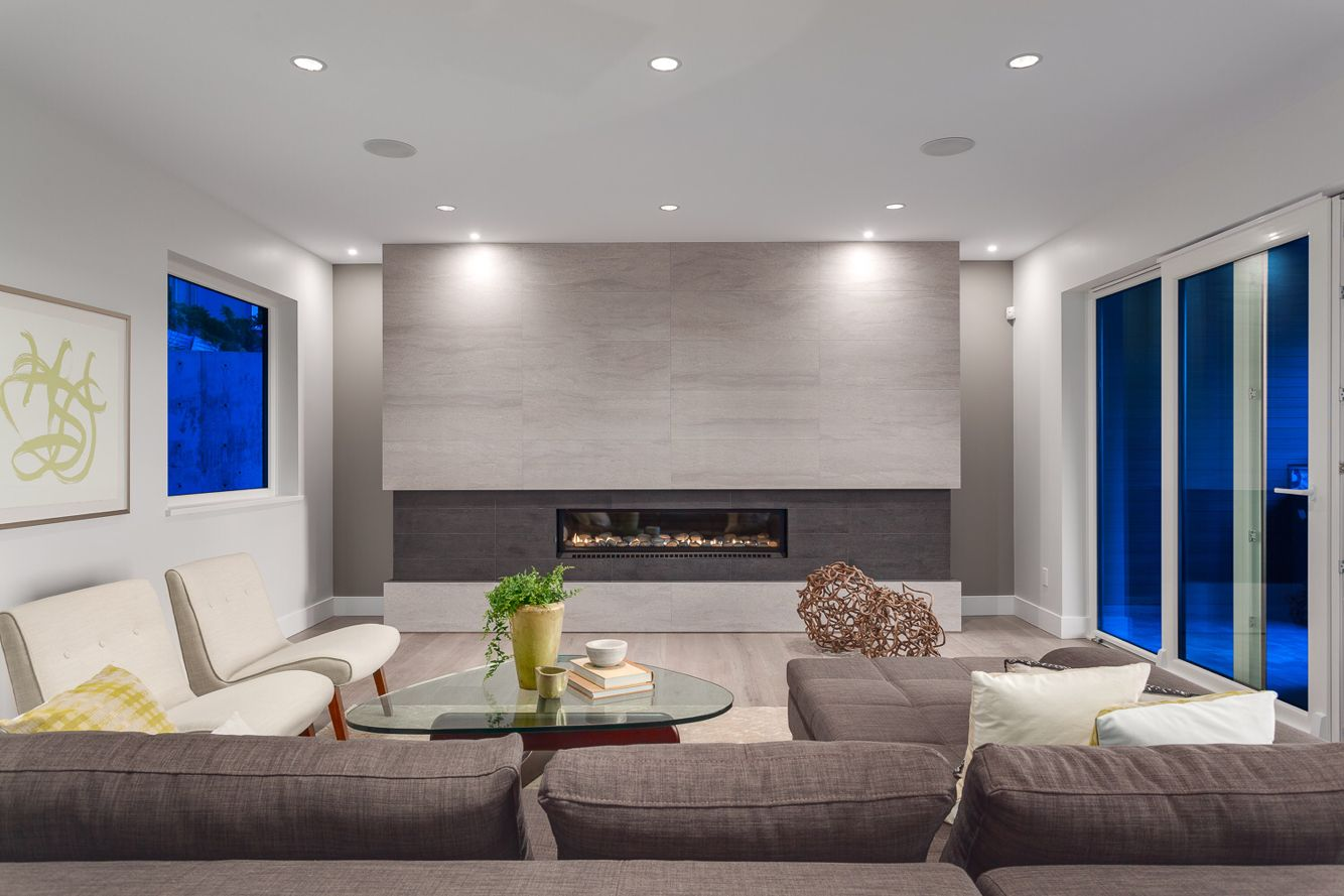 Main Living Room In Alpine Features A Linear Fireplace With Floor