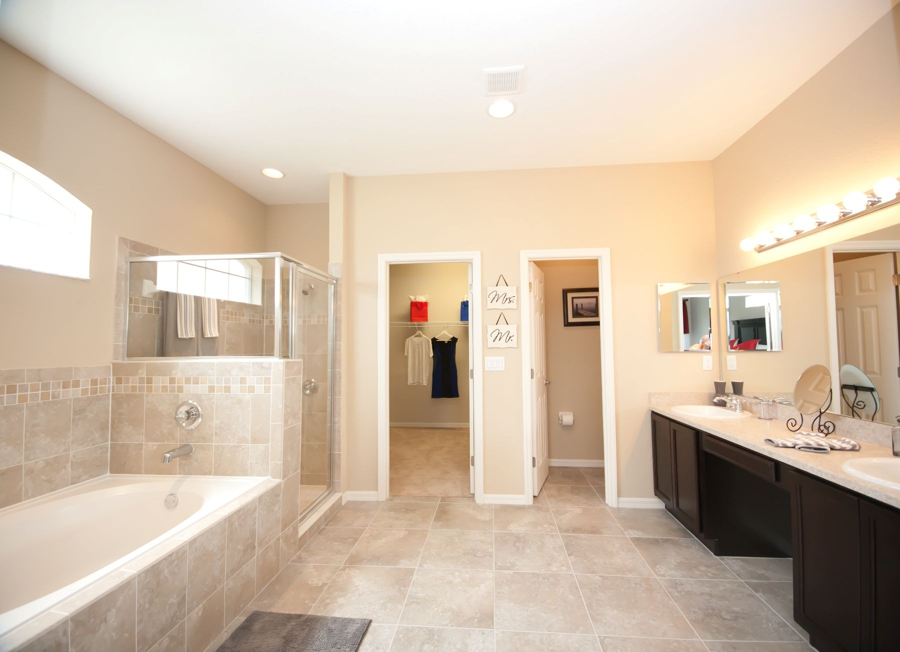 Great lighting open space and warm neutral colors make for Model home bathroom photos