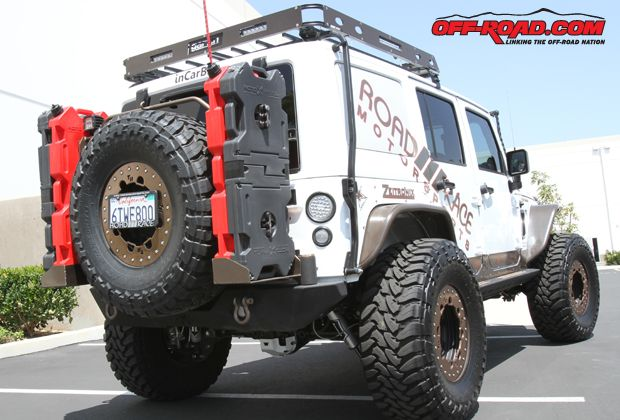 At the rear of the 2012 RRM Wrangler, a Poison Spyder RockBrawler Spare Tire Carrier hold the 37-inch spare Toyo tire. RRM fitted its RotoPax holders onto the mount, holding two 4-gallon fuel tanks and two RotoPax tool kits.