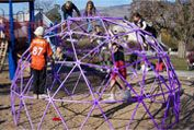 Geodesic Playground Domes:  *Frames available in many colors  *Large, clear plastic window  *Removable covers  *Cover keeps play area dry in the rain  Multicolored, fire-retardant fabric  *Screen bottom and top vent to keep cool in the summer    http://pacificdomes.com/playground_domes.html