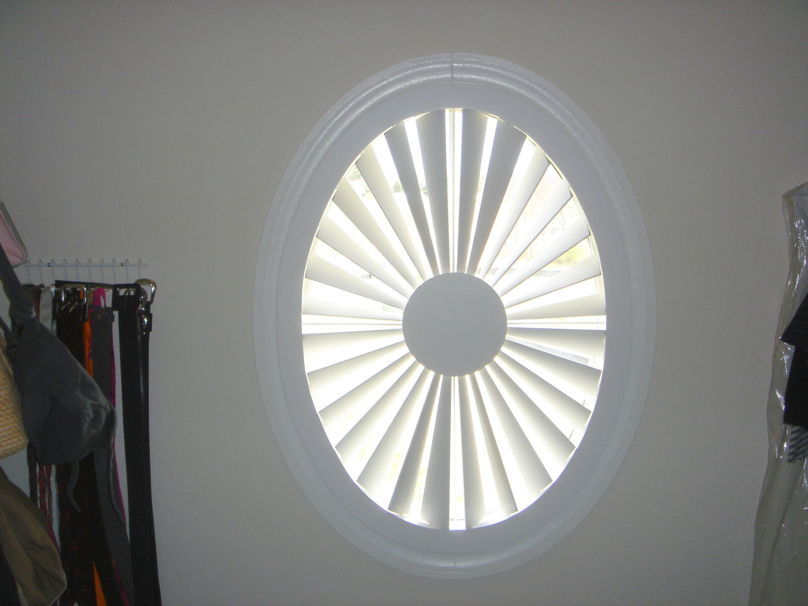 Circular Window Covered With Shutters By The Louver