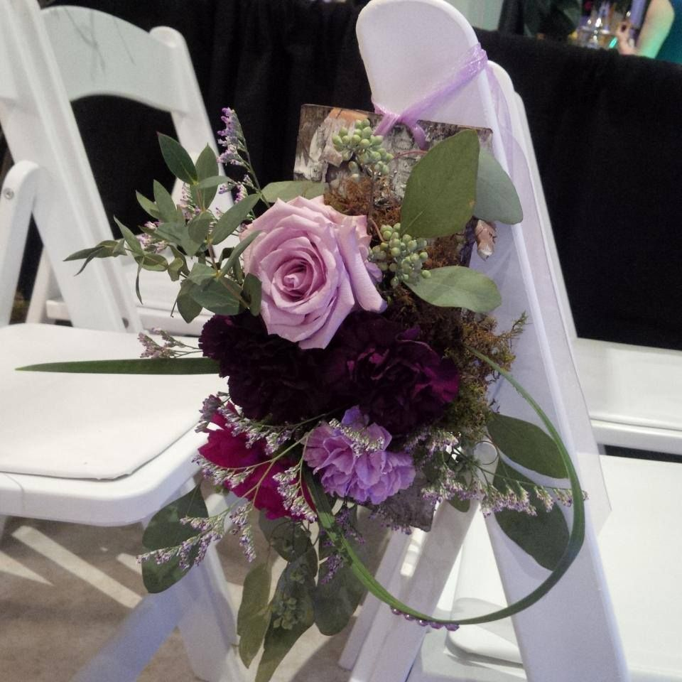 Purple flowers including quot ocean song quot roses and a variety of moon