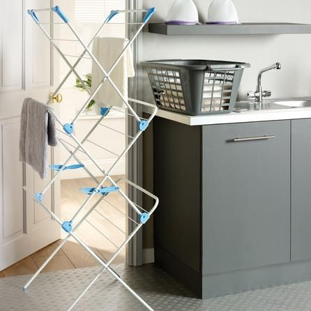 Got caught in the rain? Dry your clothes on this handy indoor airer