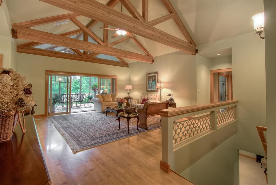 Custom daylight craftsman on shy 40 acres of private for Vaulted ceiling with exposed trusses
