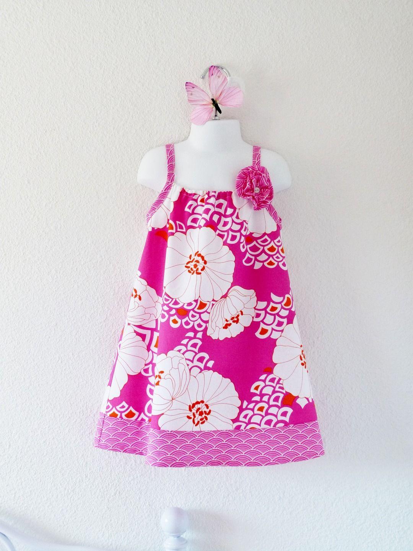 a5493a9fa87 Robe été enfant à grandes fleurs roses fuchsia tailles 2 ans