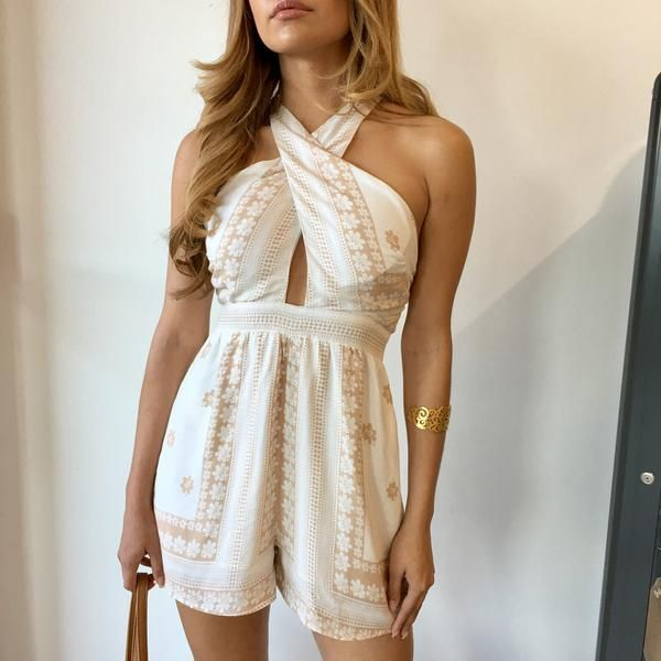 You're sure to have a magical day when you're wearing the Tabby Romper! Featuring a floral print pattern, criss-cross halter neckline, adjustable spaghetti straps and zipper back closure.