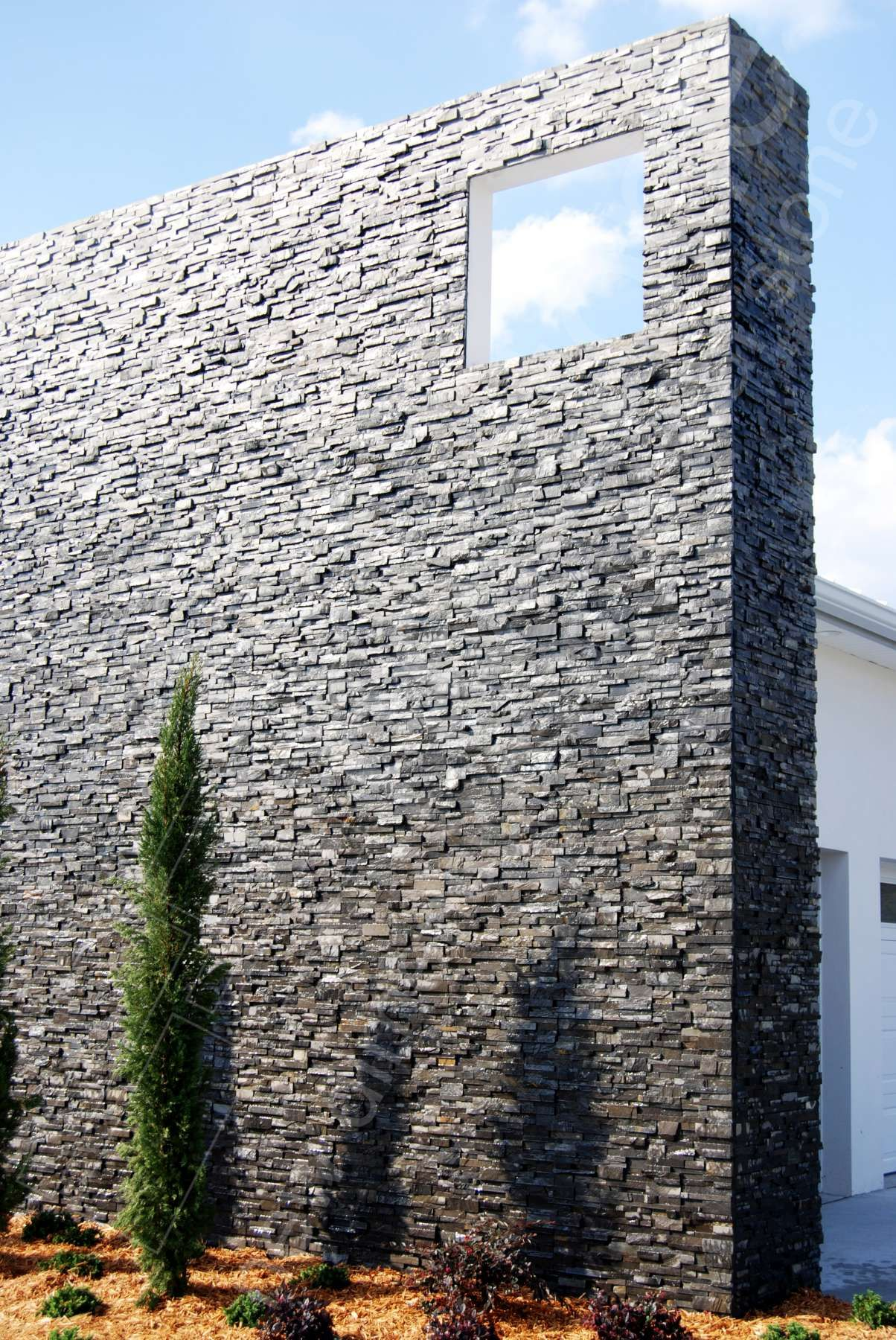 Charcoal Remarkably Simple And Cost Effective Norstone Natural Stone Wall Tiles Offer High End Stone Cladding Exterior Exterior Stone Architecture Exterior