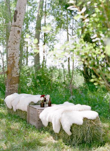 Sheepskins over hay bales.
