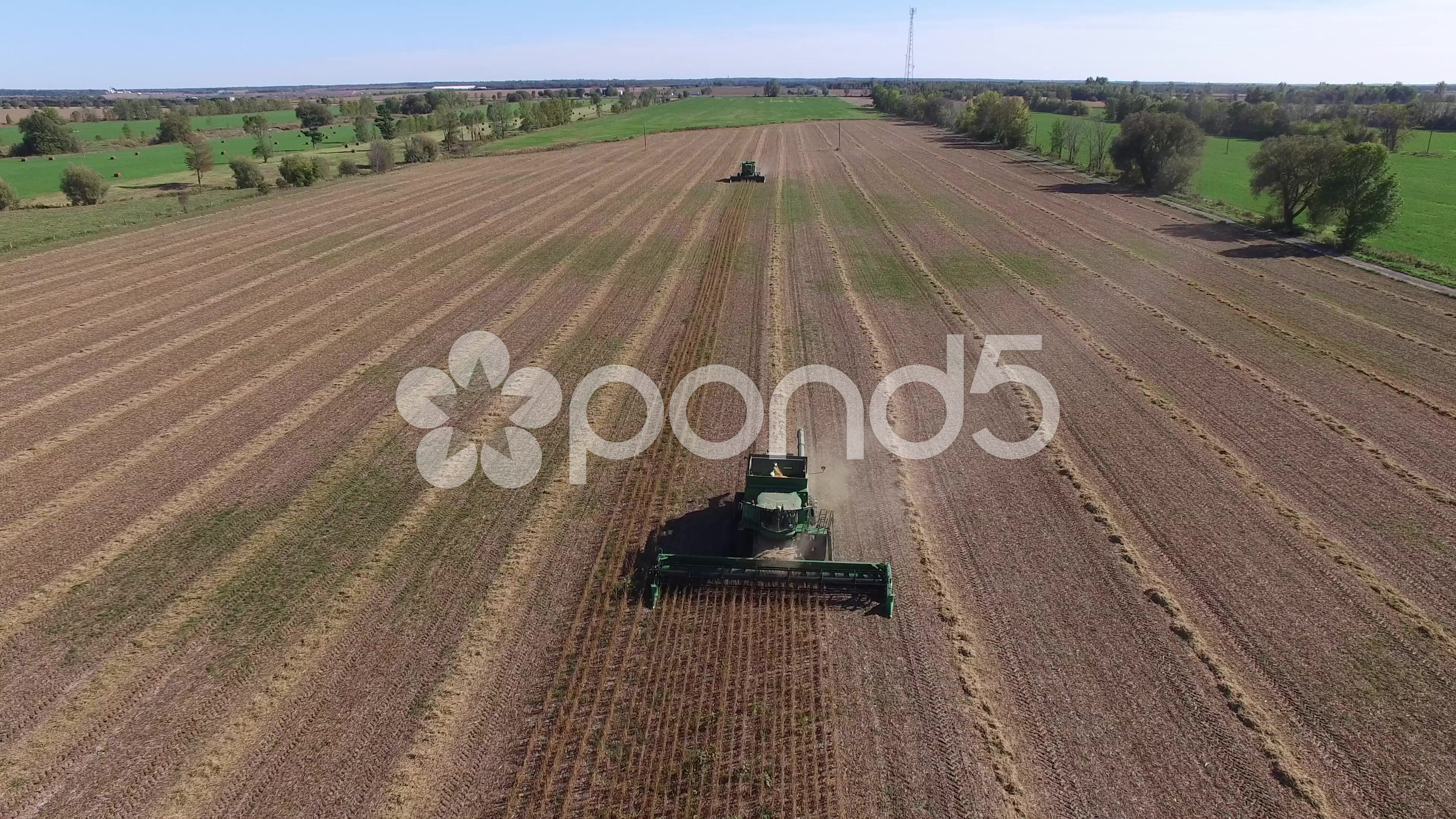 4k aerial closeup of combine tractor harvesting farm crop Stock Footage #AD ,#combine#tractor#closeup#aerial