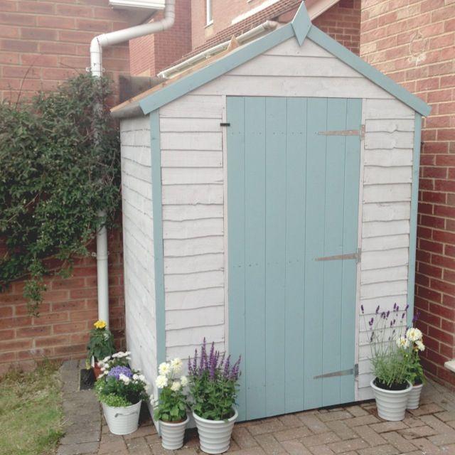 Beach hut inspired garden shed pastel blue beach house for Beach hut ideas