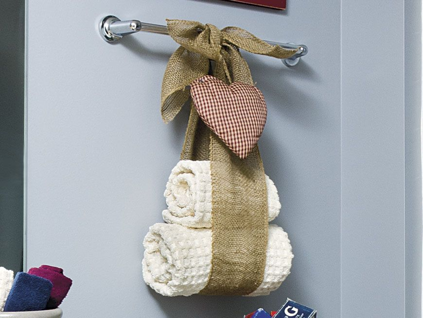 Tie burlap ribbon into a bow around a towel bar leaving a for How to tie towels in bathroom