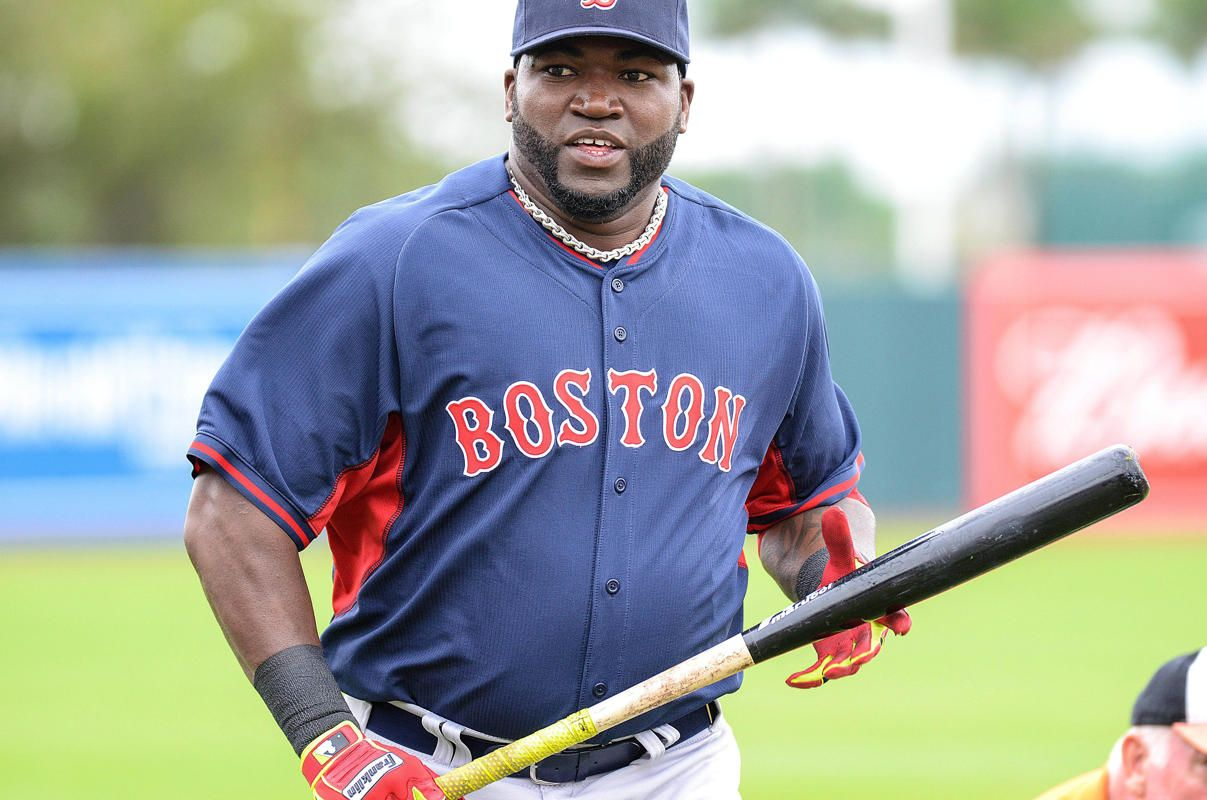 Mar 24, 2014; Sarasota, FL, USA; Boston Red Sox dh David Ortiz (34) jogs off the field before the start of the spring training exhibition ga...