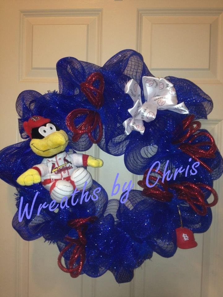 Another tribute to the World Champion STL Cardinals!  Blue deco mesh, Fredbird, a STL helmet, red flex tube bows and a white baseball bow!  Go Cards!