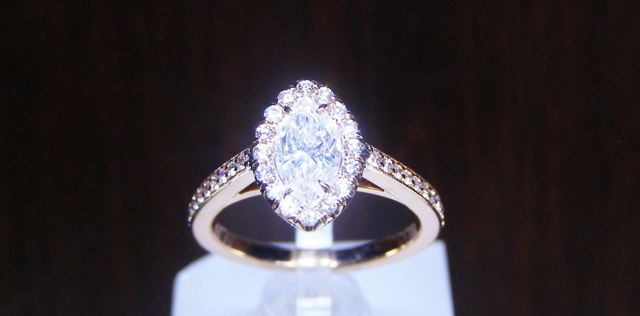 Marquise cut diamond engagement ring. Such a unique look! www.masicadiamonds.com