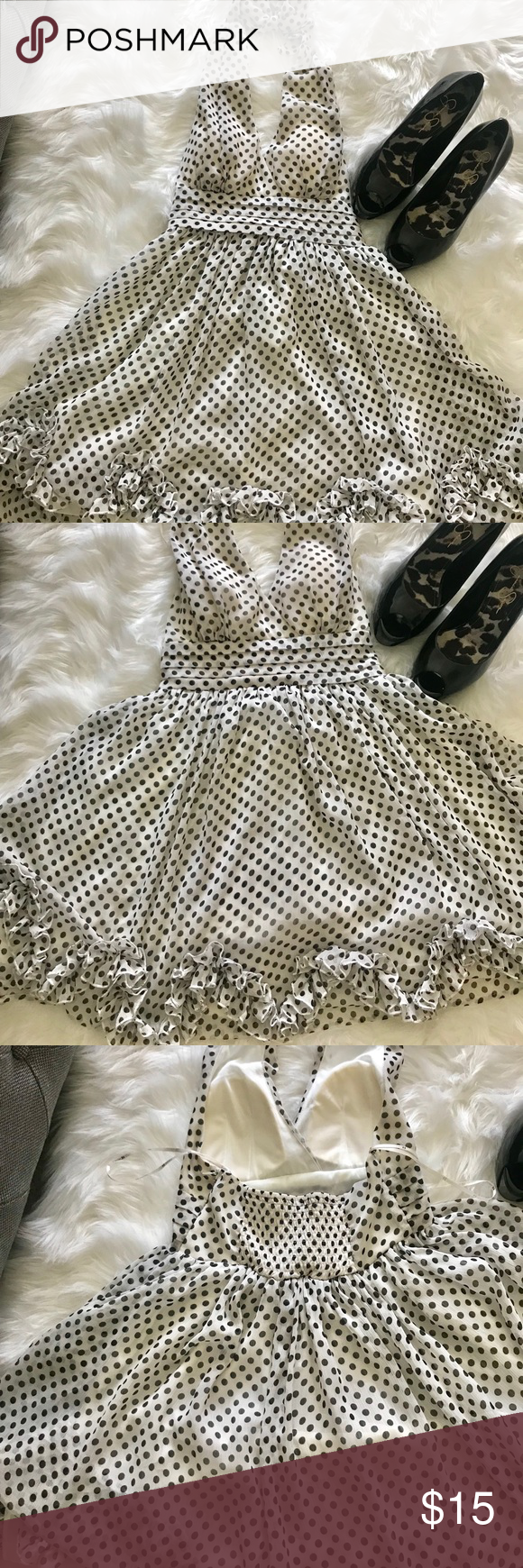 Cute  party/ cocktail dress Black and off white Polkadot halter dress.. cute for that special occasion.  This dress comes with cups in the breast area. The dress is a small but runs big ( fits like a medium) Forever 21 Dresses Backless #backlesscocktaildress